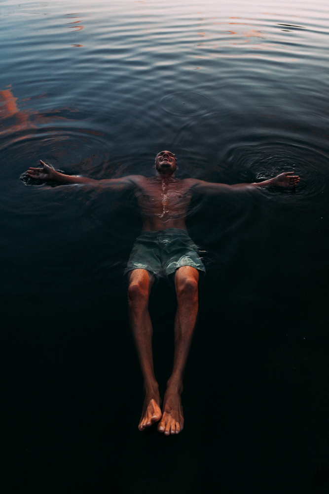 man floating in water